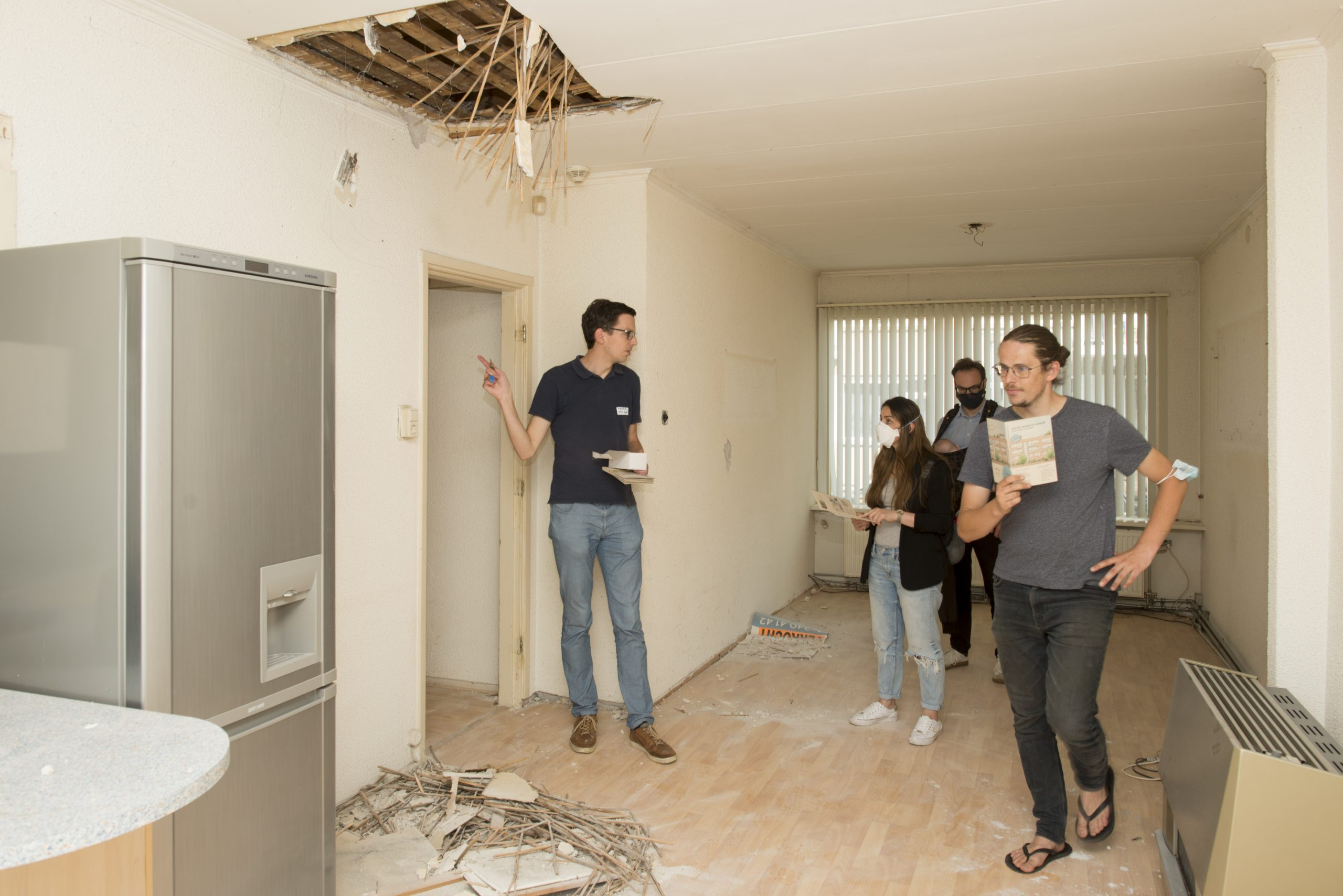 Prospective residents in a apartment open for combining